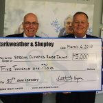 Members Hold Large Check from Starshep to Special Olympics